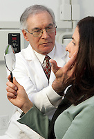 Cosmetic surgery consult with patient.