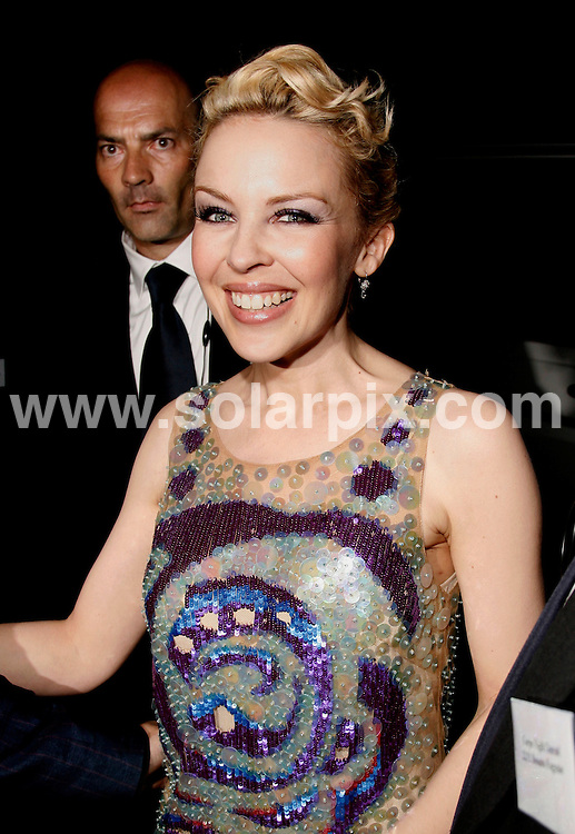 **ALL ROUND PICTURES FROM SOLARPIX.COM**.**WORLDWIDE SYNDICATION RIGHTS**.Kylie Minogue arrives at the Th ePucci party tonight in Florence Italy accumpanied by Designer friend Mathew Williamson..JOB REF: 3955         PRS/TMY        DATE: 20.5.07.**MUST CREDIT SOLARPIX.COM OR DOUBLE FEE WILL BE CHARGED* *UNDER NO CIRCUMSTANCES IS THIS IMAGE TO BE REPRODUCED FOR ANY ONLINE EDITION WITHOUT PRIOR PERMISSION*