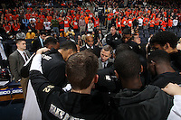 Wake Forest teammates huddle with Wake Forest head coach Jeff Bzdelik before the game against Virginia Wednesday Jan. 08, 2014 in Charlottesville, Va. Virginia defeated Wake Forest 74-51.