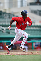 GCL Red Sox shortstop Jecorrah Arnold (17) runs to first base during a game against the GCL Rays on August 1, 2018 at JetBlue Park in Fort Myers, Florida.  GCL Red Sox defeated GCL Rays 5-1 in a rain shortened game.  (Mike Janes/Four Seam Images)