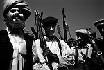 wana, waziristan, april 2004: a tribal elder addresses the men of the ahmedzai lashkar.  the lashkar was called to track down suspected al qaeda fighters and their collaborators thought to be hiding out in the south waziritan hills that border afghanistan.<br />