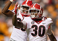 KNOXVILLE, TN - OCTOBER 5: Tae Crowder #30 of the Georgia Bulldogs celebrates his fumble recovery that he returned for a 60 yard touchdown during a game between University of Georgia Bulldogs and University of Tennessee Volunteers at Neyland Stadium on October 5, 2019 in Knoxville, Tennessee.