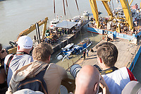 Photographers take pictures as rescue personnel work on lifting up the passenger boat Hableany (means Mermaid in Hungarian) from the river almost two weeks after it's capsize in an accident on river Danube in downtown Budapest, Hungary on June 11, 2019. ATTILA VOLGYI
