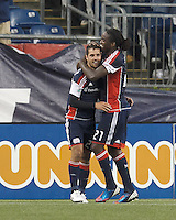 New England Revolution forward Benny Feilhaber (22) celebrates his goal with New England Revolution midfielder Shalrie Joseph (21). In a Major League Soccer (MLS) match, the New England Revolution defeated Chicago Fire, 2-0, at Gillette Stadium on June 2, 2012.