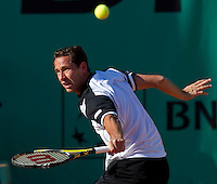 Michael Llodra (FRA) against Thomaz Bellucci (BRA) (24) in the first round of the men's singles. Thomaz Bellucci beat Michael Llodra 6-4 6-2 6-2..Tennis - French Open - Day 2 - Mon 24 May 2010 - Roland Garros - Paris - France..© FREY - AMN Images, 1st Floor, Barry House, 20-22 Worple Road, London. SW19 4DH - Tel: +44 (0) 208 947 0117 - contact@advantagemedianet.com - www.photoshelter.com/c/amnimages