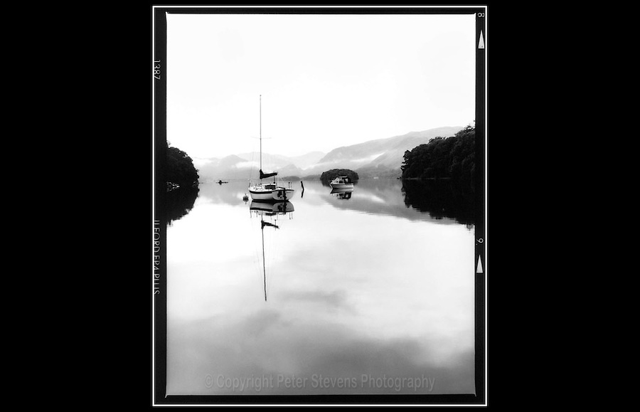 Derwentwater -  Lake District National Park - Cumbria - 12th August 1993 - <br /> <br /> The lake occupies part of Borrowdale and lies immediately south of the town of Keswick.  It is surrounded by hills (known locally as fells), and many <br /> of the slopes facing Derwentwater are extensively wooded. The Lake measures approximately 3 miles long by 1 mile wide and is some 22 m deep.