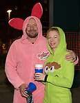 Jason and Jami during the Onesie Crawl held on Saturday night, Nov. 18, 2017 in downtown Reno.