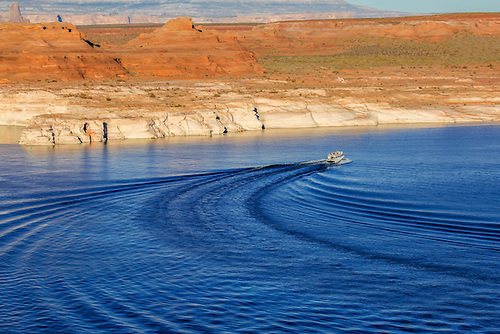 A tour guide boat motors through Lake Powell near Page, Arizona