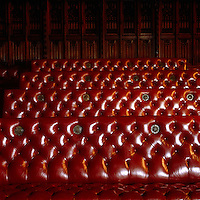 Detail of the benches in the Chamber: red has been the House of Lords' colour since the 16th century and the brass portholes conceal speakers