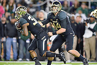 Baylor quarterback Bryce Petty (14) handoff to running back Shock Linwood (32) during an NCAA football game, Saturday, December 06, 2014 in Waco, Tex. (Mo Khursheed/TFV Media via AP Images)