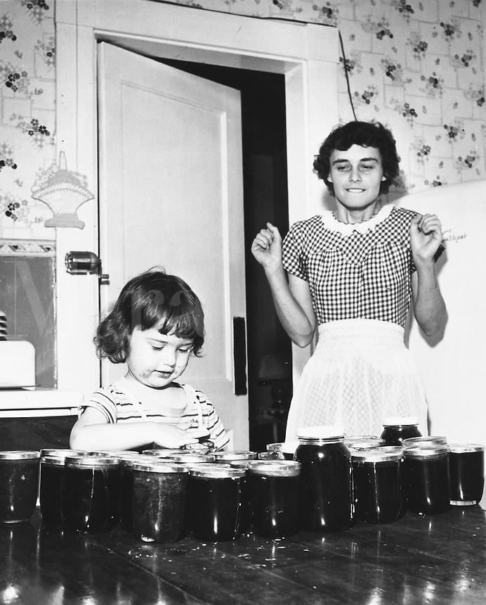 Helping mom make preserves.