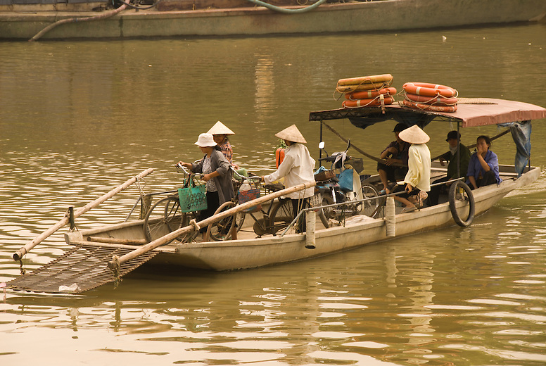 A concrete boat transports people to the small rural village of Tho Ha, just outside of Hanoi, Vietnam.