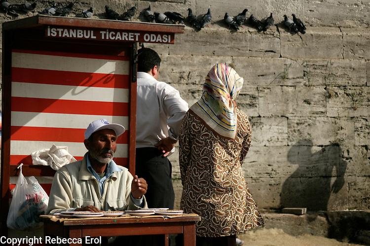 Blind man seling pigeon feed in Eminonu, istanbul, Turkey