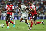 Real Madrid's Mariano and Stade de Remis's Charbonnier during the XXXVII Bernabeu trophy between Real Madrid and Stade de Reims at the Santiago Bernabeu Stadium. August 15, 2016. (ALTERPHOTOS/Rodrigo Jimenez)