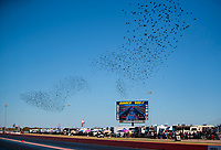 Oct 18, 2019; Ennis, TX, USA; Migratory birds fly in a flock over the track during NHRA qualifying for the Fall Nationals at the Texas Motorplex. Mandatory Credit: Mark J. Rebilas-USA TODAY Sports