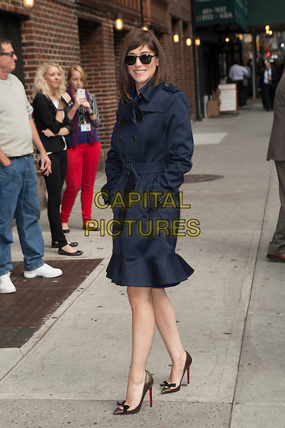 Lizzy Caplan <br /> visits the Late Show With David Letterman, New York City, New York, USA.<br /> September 25th, 2013 <br /> full length blue mac trench coat sunglasses shades hands in pockets <br /> CAP/MPC/COR<br /> &copy;Corredor99/ MediaPunch/Capital Pictures