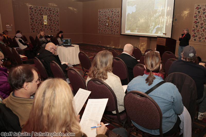 January 8, 2013   Communications volunteer ,Andi Malard, talks with potential and returning Iditarod volunteers  at a pre-race meeting for volunteers at the Millenium Hotel Redington Ballroom to discuss postions for this year's Iditarod race to begin March 2nd in downtown Anchorage.