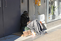 A homeless man in the doorway of the Marks & Spencer store at Marble Arch. The deserted streets show the severe effects of the COVID-19 epidemic on London on 23rd March 2020