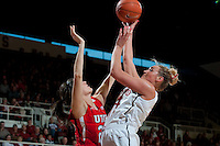 STANFORD, CA--Joslyn Tinkle goes over a Utah defender during PAC-12 conference play against Utah  at Maples Pavilion. The Cardinal won the matchup against the Utes 69-42.