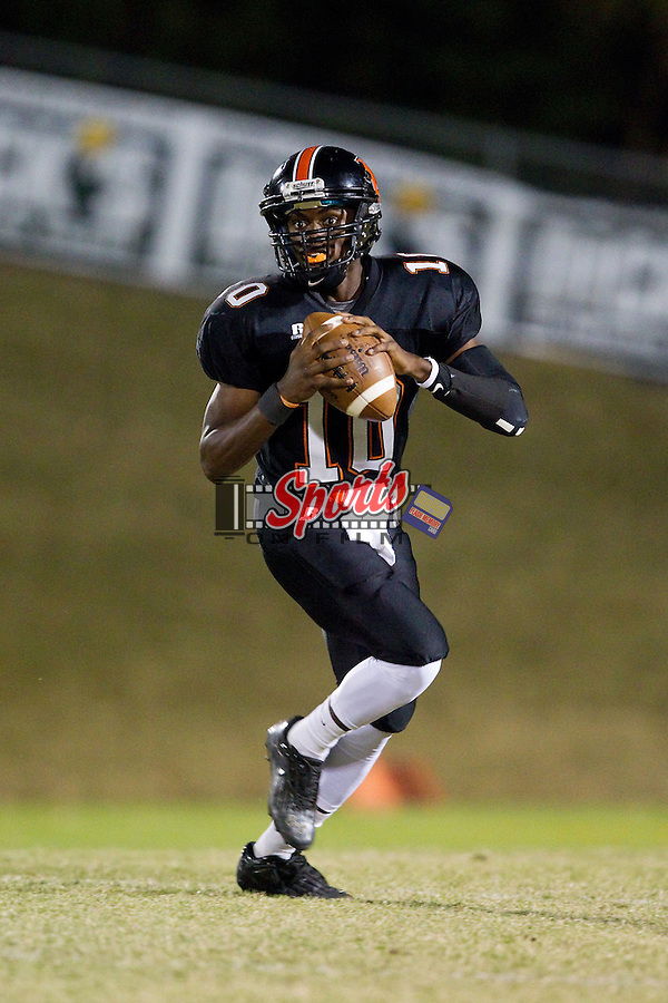 Brandon White (10) of the Northwest Cabarrus Trojans during first half action against the East Rowan Mustangs at Trojan Stadium October 11, 2013, in Concord, North Carolina.  The Mustangs defeated the Trojans 42-14.  (Brian Westerholt/Sports On Film)
