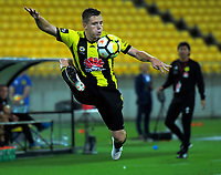Scott Galloway controls the ball during the A-League football match between Wellington Phoenix and Adelaide United at Westpac Stadium in Wellington, New Zealand on Saturday, 27 January 2018. Photo: Dave Lintott / lintottphoto.co.nz