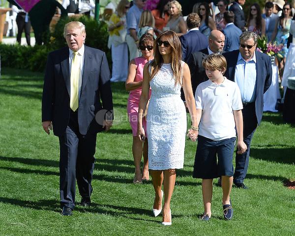 PALM BEACH FL - JANUARY 4: Donald Trump, Melania Trump and Barron Trump attend The Trump Invitational Grand Prix at Club Mar-a-Lago on January 4, 2015 in Miami, FL Florida. Credit: mpi04/MediaPunch