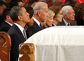 Boston, MA - August 29, 2009 -- The white draped casket of Senator Edward Kennedy sits in front of President Barack Obama and first lady Michelle Obama, Vice President Joseph Biden and his wife Jill, former first lady Rosalynn Carter and former President Jimmy Carter . during funeral services for U.S. Senator Edward Kennedy at the Basilica of Our Lady of  Perpetual Help in Boston, Massachusetts August 29, 2009.  Senator Kennedy died late Tuesday after a battle with cancer.    .Credit: Brian Snyder- Pool via CNP