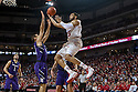 March 1, 2014: Walter Pitchford (35) of the Nebraska Cornhuskers with a lay up against Tre Demps (14) of the Northwestern Wildcats during the second half at the Pinnacle Bank Arena, Lincoln, NE. Nebraska 54 Northwestern 47.