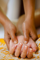 A therapist treating one of the guests at the Maia Luxury Resort & Spa