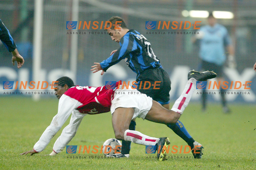 MILANO 25/11/2003 <br /> Champions League Inter Arsenal 1-5<br /> Kanu (Arsenal) Fabio Cannavaro (Inter)<br /> Photo Andrea Staccioli Insidefoto