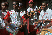 Salvador, Brazil. Group of musicians on the street during carnival with drums, pandeira, ukelele and tambourine.