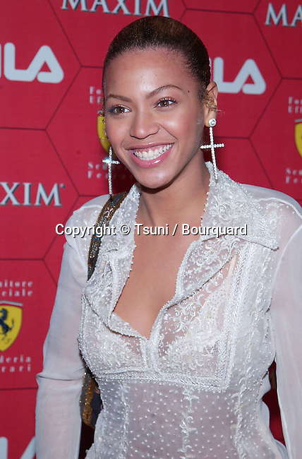 Beyonce Knowles arriving at the Seduction Of Speed an evening with the magazine Maxim at the Lounge @ Astra in Los Angeles. March 14, 2002.           -            KnowlesBeyonce17.jpg