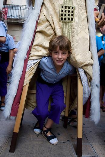 Vilafranca del Pnedes, Barcelona, Catalonia, childrens day, gegantes, 11 years old Francesc dances inside the giant figure of King James I