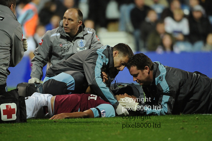 Winston Reid of West Ham United is injured during the Barclays Premier League match between West Ham United and Queens Park Rangers at Loftus Road on Monday ,01 October 2012 in London, England. Picture Zed Jameson/pixel 8000 ltd