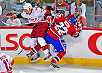 21 December 2008: Carolina Hurricanes' defenseman Joe Corvo is checked by Montreal Canadiens' left wing forward Steve Begin in the first period at the Bell Centre in Montreal, Quebec, Canada. The Hurricanes defeated the Canadiens 3-2 in overtime. ***** Editorial Sales Only ***** Mandatory Photo Credit: Ed Wolfstein Photo