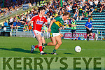 Kerry's Fiachra Clifford been marked tightly by Colm O'Callaghan of Cork during the Munster U20 Football final in Austin Stack Park on Friday.