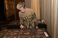 Frances McDormand signs a poster backstage with the Oscar&reg; for performance by an actress in a leading role for work on &ldquo;Three Billboards Outside Ebbing, Missouri&rdquo; during the live ABC Telecast of The 90th Oscars&reg; at the Dolby&reg; Theatre in Hollywood, CA on Sunday, March 4, 2018.<br /> *Editorial Use Only*<br /> CAP/PLF/AMPAS<br /> Supplied by Capital Pictures