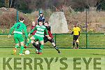 Wayne Sparling Killarney Celtic turns Ringmahon Rangers defence during the Munster Junior cup in Celtic Park on Sunday