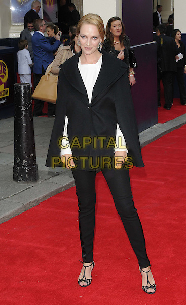 Uma Thurman<br /> 'Charlie And The Chocolate Factory' press night, Theatre Royal, Drury Lane, London, England.<br /> 25th June 2013<br /> full length black trousers cape poncho jacket white top<br /> CAP/CAN<br /> &copy;Can Nguyen/Capital Pictures