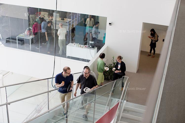 People walk through the MIT Media Lab in Cambridge, Massachusetts, USA.