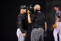 Bradenton Marauders manager Gerardo Alvarez (18) talks with an umpire during a game against the Tampa Yankees on April 15, 2017 at George M. Steinbrenner Field in Tampa, Florida.  Tampa defeated Bradenton 3-2.  (Mike Janes/Four Seam Images)
