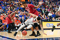 NWA Democrat-Gazette/CHARLIE KAIJO Arkansas Razorbacks forward Daniel Gafford (10) collides with Florida Gators guard Chris Chiozza (11) during the Southeastern Conference Men's Basketball Tournament quarterfinals, Friday, March 9, 2018 at Scottrade Center in St. Louis, Mo.