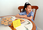 7 year old girl singing to herself to distract herself from desire to take a forbidden cookie horizontal