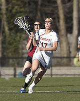 Boston College midfielder Mikaela Rix (17) brings the ball forward.