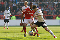 Daniel James of Swansea City (R) closely followed by Molla Wague of Nottingham Forest during the Sky Bet Championship match between Nottingham Forest and Swansea City at City Ground, Nottingham, England, UK. Saturday 30 March 2019