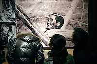 Visitors look at a photo exhibition at The Memorial Hall of the Nanjing Massacre in Nanjing, Jiangsu, China on Dec. 13, 2009.  The photos depict violence against Chinese people during the Nanjing Massacre. On Dec. 13, 2009, thousands of people visited The Memorial Hall of the Nanjing Massacre in Nanjing, Jiangsu, China, to remember those who died at the hands of Japanese soldiers in 1937-8.  The day marked the 72nd anniversary of the start of the massacre. The historical account has always been mired in controversy, and differing opinions on what actually happened have been a consistent obstacle to relations between China and Japan.  China's official account of history states that 300,000 people were killed by Japanese forces over a 6-week period starting Dec. 13, 1937