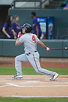 Stephen Perez (4) of the Potomac Nationals follows through on a solo home run in the top of the 1st inning against the Winston-Salem Dash at BB&T Ballpark on April 30, 2015 in Winston-Salem, North Carolina.  The Nationals defeated the Dash 5-4..  (Brian Westerholt/Four Seam Images)