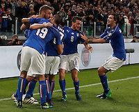 Italy Daniele De Rossi, left, celebrates with teammates after scoring the equalizer goal on a penalty kick during the Fifa World Cup 2018 qualification soccer match between Italy and Spain at Turin's Juventus Stadium, October 6, 2016. The game ended 1-1.<br /> UPDATE IMAGES PRESS/Isabella Bonotto