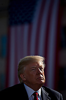 United States President Donald J. Trump listens during a ceremony to commemorate the September 11, 2001 terrorist attacks, at the Pentagon in Washington, D.C., U.S., on Monday, Sept. 11, 2017. Trump is presiding over his first 9/11 commemoration on the 16th anniversary of the terrorist attacks that killed nearly 3,000 people when hijackers flew commercial airplanes into New York's World Trade Center, the Pentagon and a field near Shanksville, Pennsylvania. <br /> CAP/MPI/CNP/RS<br /> &copy;RS/CNP/MPI/Capital Pictures