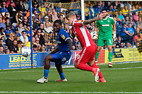 Deji Oshilaja of AFC Wimbledon and Stephen Humphrys of Scunthorpe United during AFC Wimbledon vs Scunthorpe United, Sky Bet EFL League 1 Football at the Cherry Red Records Stadium on 15th September 2018